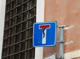 A street sign with decals by Clet Abraham (Rome)