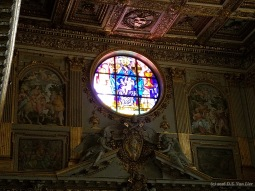 A stained glass window inside Basilica di Santa Maria Maggiore.