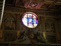 A stained glass window inside Basilica di Santa Maria Maggiore.