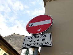 """A """"Do Not Enter"""" sign with decals by Clet Abraham (Florence)"""