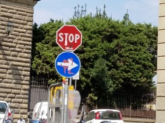 Street signs with decals by Clet Abraham (Florence)