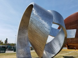 """Wandering the Immeasurable"" sculpture in front of the Globe of Science and Innovation at CERN in Geneva."