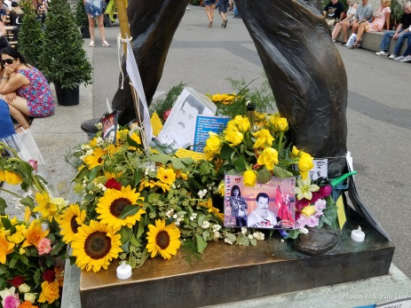 Close-up of some tribute items left on the statute of Freddie Mercury