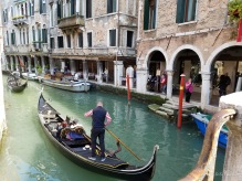 A gondola makes its way along a Venice canal