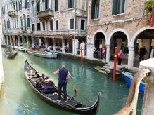 A gondola makes its way along a Venice canal